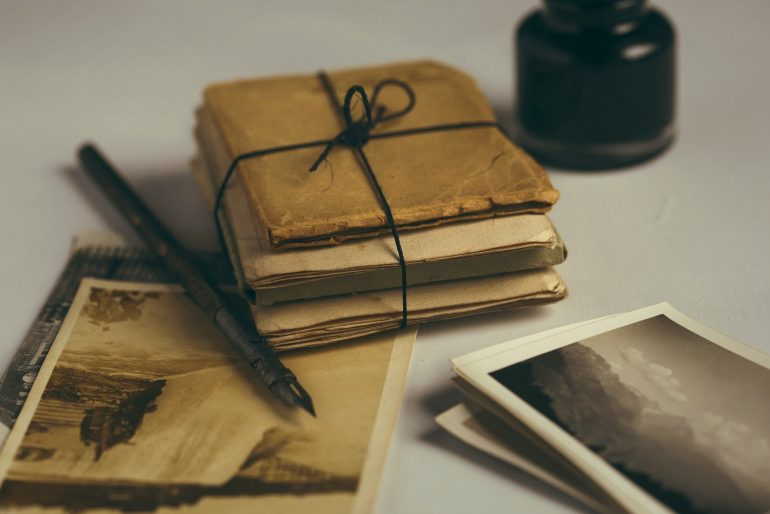 bundle of old family letters and photographs